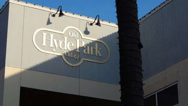 July 14, 2015 - Old Hyde Park Village emblem on building where On Swann Restaurant is being built on Swan Ave in Tampa, FL