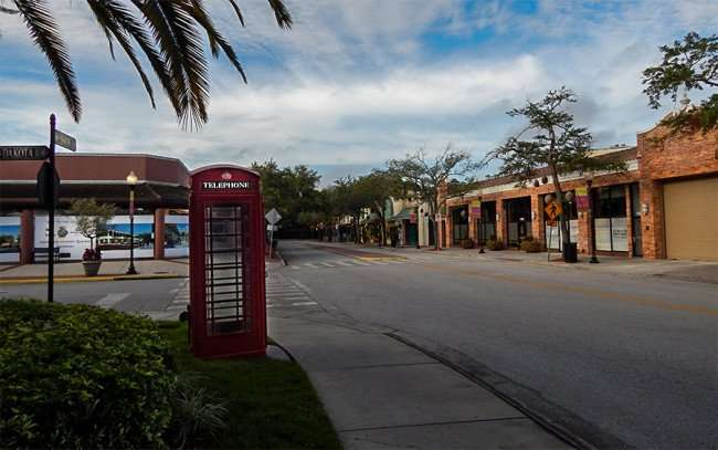NOV 8, 2015 - Old red telephone booth in Hyde Park Village, Tampa, FL/photonews247.com