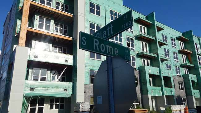 July 19, 2015 - Platt St. and Rome Ave. street sign with Broadstone Apartments in background, Tampa, FL