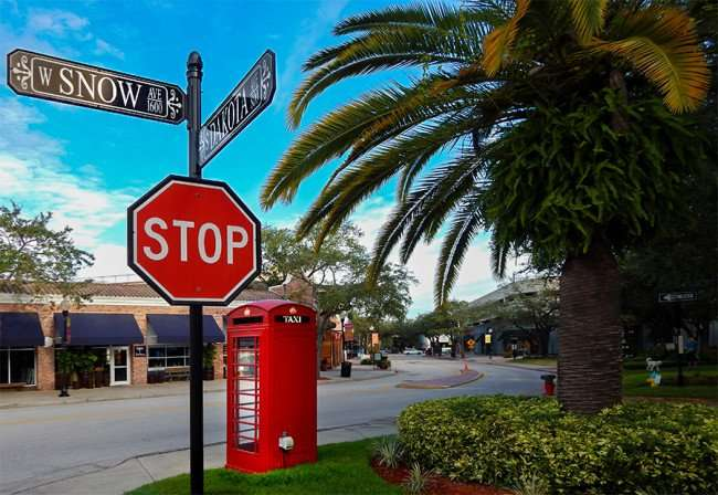 NOV 8, 2015 - Red British Phone Booth on corner of W Snow Ave and S Dakoto Ave, Hyde Park Village, Tampa, FL/photonews247.com