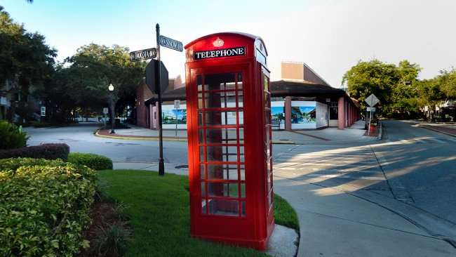 JULY 19, 2015 - Authentic red British telephone booth on Snow Ave. in the Hyde Park Village shopping plaza in Tampa, FL