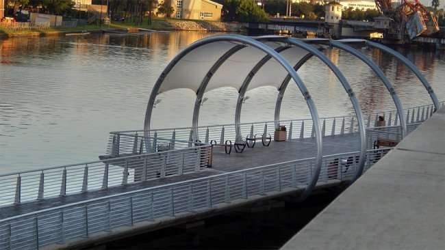 JULY 26, 2015 - Riverwalk plateform with canopy along Hillsborough River by Rivergate Towers, downtown Tampa, FL/photonews247.com