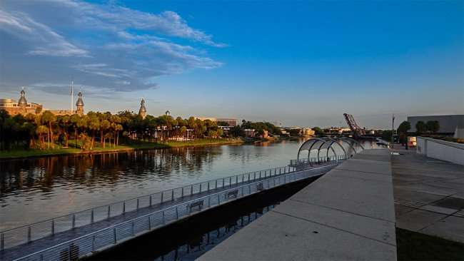 JULY 26, 2015 - Riverwalk with University of Tampa UT campus in view across Hillsborough River downtown Tampa, FL/photonews247.com