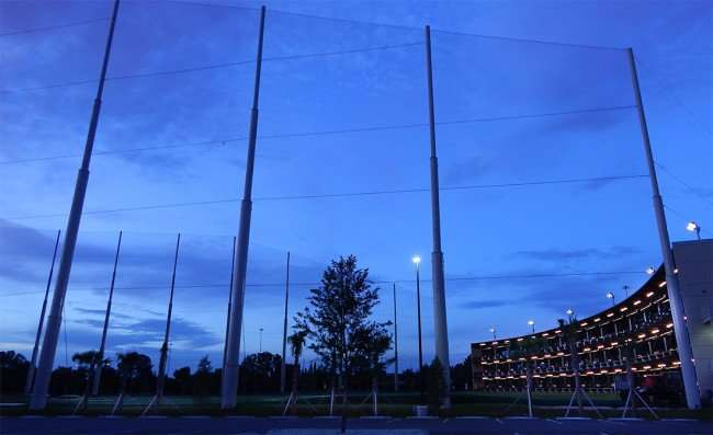TOPGOLF Tampa driving range and dining facility with hundreds of feet of netting in Brandon Tampa, FL