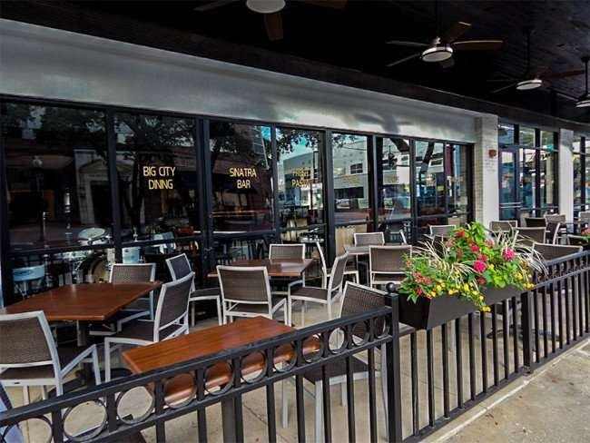 NOV 8, 2015 - Timpano Restaurant features dining outside with canopy on patio along sidewalk, Hyde Park Village, Tampa, FL/photonews247.com