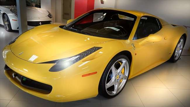 July 14, 2015 - A yellow Ferrari Italia next to wall is part of private collection inside the Ferrari of Tampa Bay showroom in Palm Harbor, Pinellas County, FL