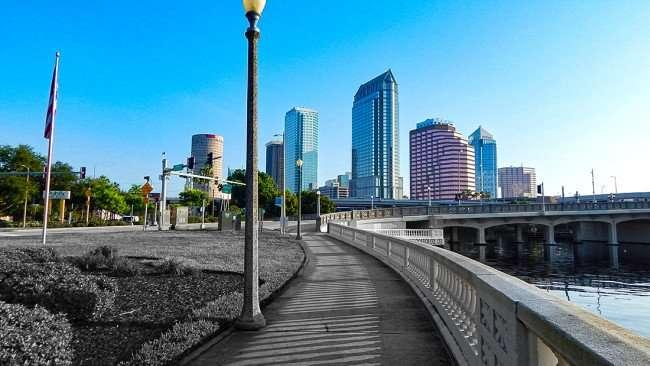 AUG 9, 2015 - Bayshore Walk with Tampa cityscape heading towards Platt St Bridge, Downtown Tampa, FL/photonews247.com