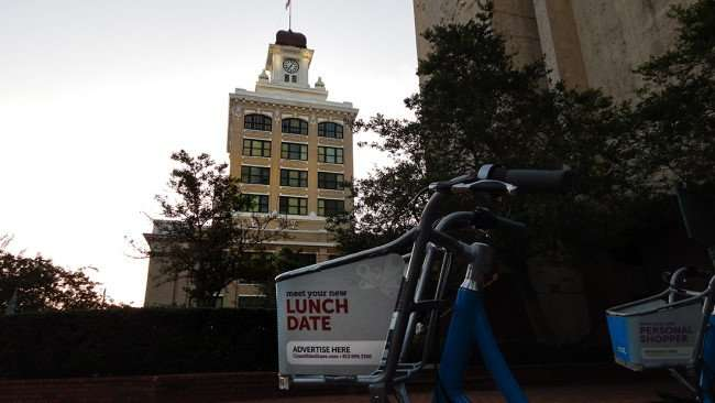 AUG 9, 2015 - Coast rental bikes at Municipal Office building with Tampa City Hall in background, Tampa, FL/photonews247.com