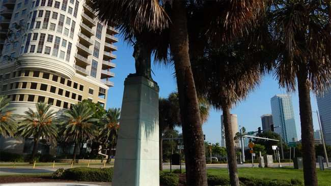 AUG 9, 2015 - Columbus Statue Park with Parkside of One Bayshore apartments in background across Bayshore Blvd in Tamap, FL/photonews247.com