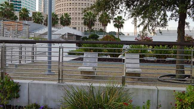 AUG 23, 2015 - Concrete chairs in Curtis Hixon Waterfront Park with Rivergate in background, Tampa, FL/photonews247.com