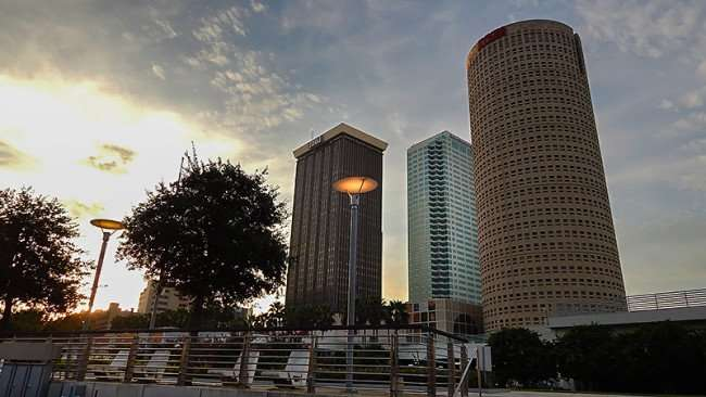 AUG 23, 2015 - Curtis Hixon Waterfront Park at dawn with lights on and skyscrapers in background, Tampa, FL/photonews247.com