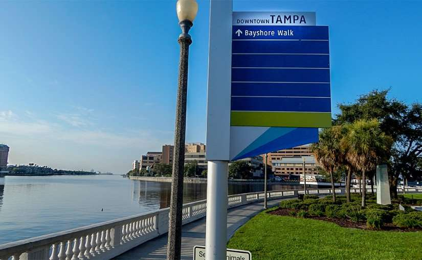 AUG 9, 2015 - Downtown Tampa sign with arrow pointing to Bayshore Walk along waterfront sidewalk/photonews247.com