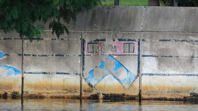 AUG 23, 2015 - Faded graffiti on Hillsborough River seawall in Tampa, FL/photonews247.com