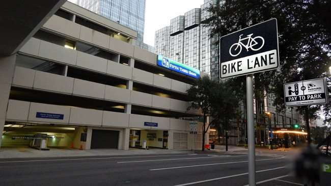 AUGUST 9, 2015 - Fifth Third Center parking garaged on Tampa Street in Downtown Tampa. Included in photo: Bike Lane, Pay Parking, Hilton Hotel, One Tampa Center (PNC tallest in pic). Standing at BOA building on Tampa St. in Downtown Tampa, FL/photonews247.com