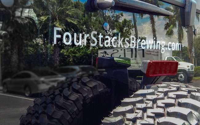 AUGUST 4, 2015 - Four Stacks Brewing Company jeep reflecting palm trees from back window/photonews247.com