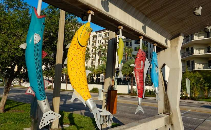 AUG 9, 2015 - Four artificial fish hanging from hooks along Bayshore Walk on Bayshore Blvd, Downtown Tampa, FL/photonews247.com