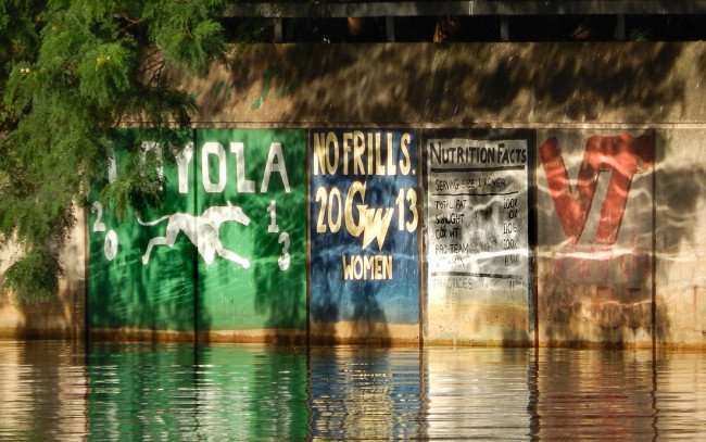 AUG 23, 2015 - Graffiti along Hillsborough River - LOYOLA 2013, GW Women's 2013, VT Crew Rowing Teams/photonews247.com