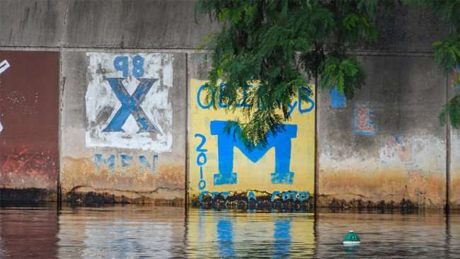 AUG 23, 2015 - Graffiti on Hillsborough River seawall 98 X MEN/photonews247.com