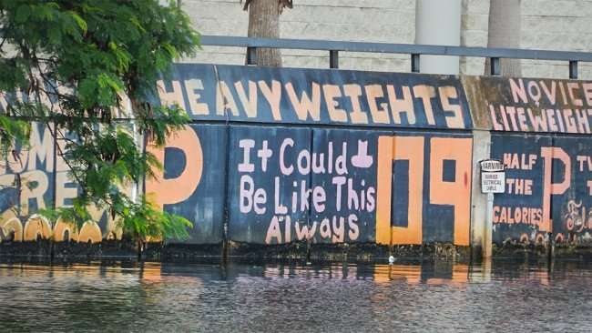 AUG 23, 2015 - Graffiti on seawall of Hillsborough River reads - Heavyweights Princeton It Could Be Like This Always 09, Tampa, FL/photonews247.com