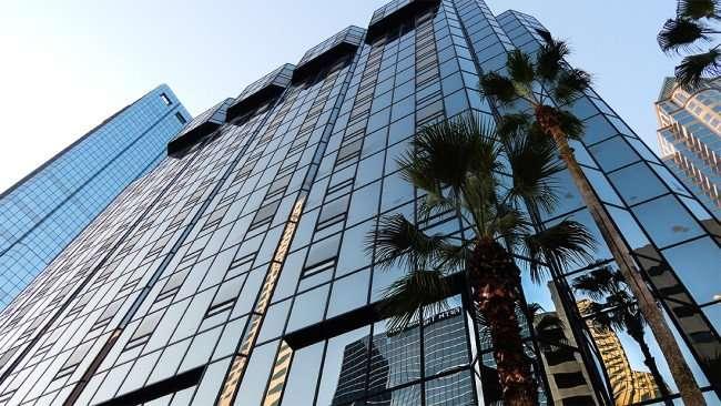 AUG 9, 2015 - Hilton Tampa Downtown reflecting Fifth Third bank like a mirror on glass/photonews247.com