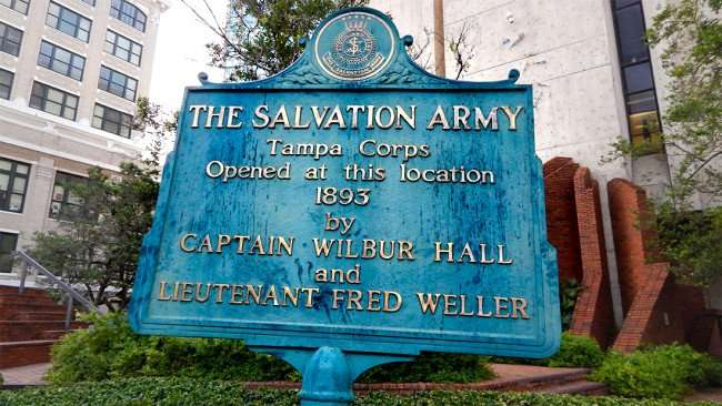AUG 9, 2015 - Landmark sign in back of Tampa's Municipal Building that reads Salvation Army Tampa Corps Opened at this location 1893/photonews247.com