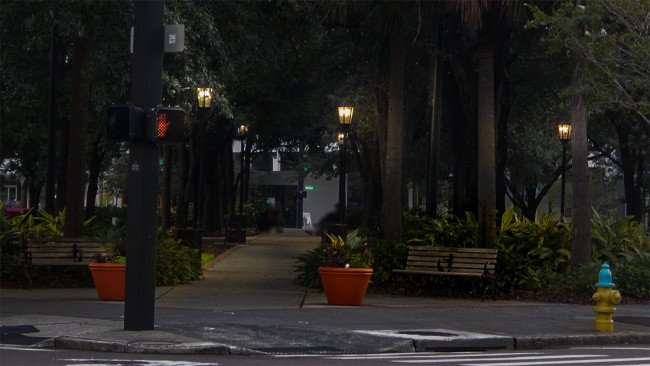AUG 9, 2015 - Lykes Gaslight Park with grass, shade trees, flowers, park benches Downtown Tampa, FL/photonews247.com