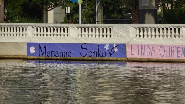 AUG 9, 2015 - MARIANNE SEMKO graffiti painted on Hillsborough River wall along Bayshore Blvd, Downtown Tampa, FL/photonews247.com