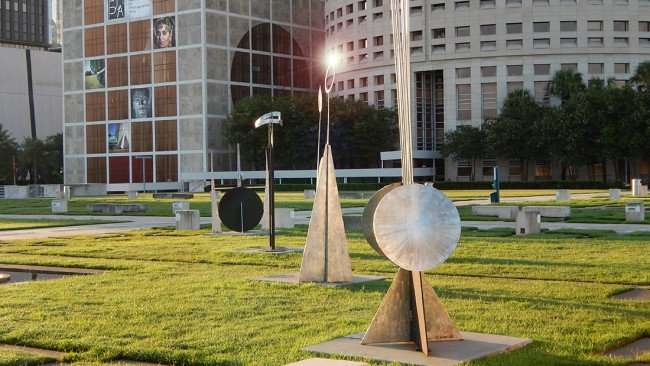 JULY 26, 2015 - Metal sculpture reflecting sun in Nations Bank Park (Kiley Garden) with Photography Art Museum in the background, Tampa, FL/photonews247.com