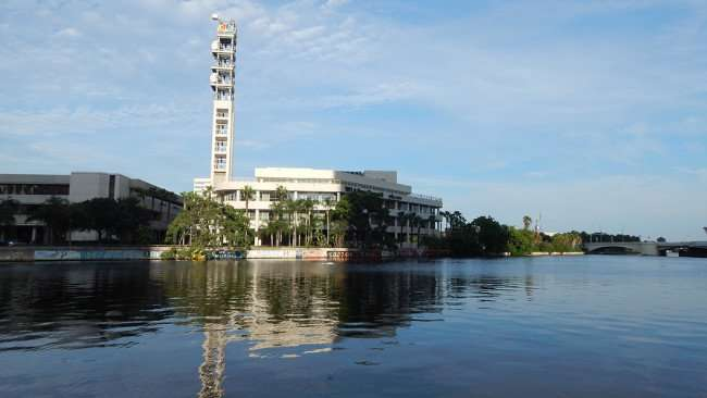 AUG 23, 2015 - NBC Tower for News Channel 8 and Graffiti along Hillsborough River viewed from MacDill Park on the Tampa Riverwalk Downtown, Florida/photonews247.com