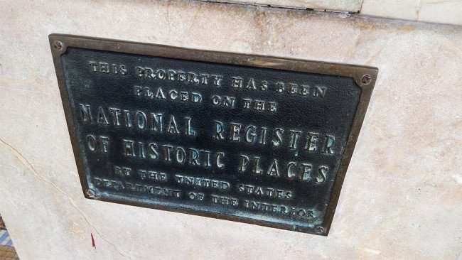 JULY 26, 2015 - National Register Of Historic Places marker plate on Tampa Theatre building/photonews247.com