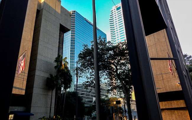 AUG 9, 2015 - One Tampa City Center (PNC) reflecting Fifth Third Center, Bank of America, Municipal Office/photonews247.com