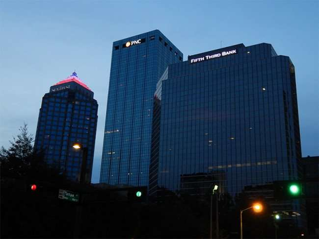 NOV 15, 2015 - PNC One Tampa City Center stands between SunTrust and Fifth Bank at dawn from Tampa ST/photonews247.com