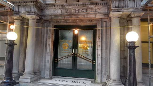 AUG 9, 2015 - Pillar entrance with engraved and tile lettering at Historic Tampa City Hall/photonews247.com