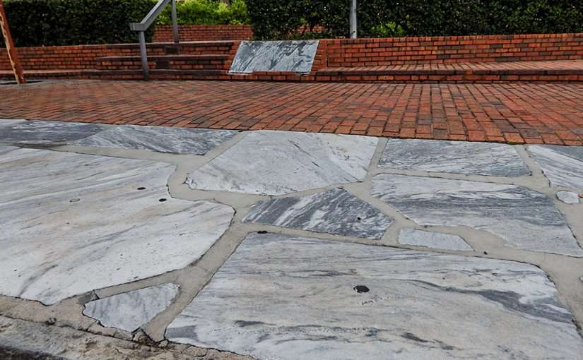 AUG 9, 2015 - Remnants of first paved sidewalk out of Georgia Marble built 1888 preserved on Kennedy Blvd by Municipal Office building Downtown Tampa/photonews247.com