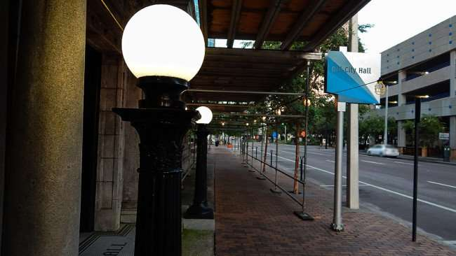 AUG 9, 2015 - Tampa City Hall sidewalk with scaffolding and two lamp posts at entrance along Kennedy Blvd/photonews247.com