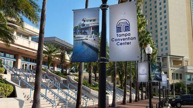 AUG 9, 2015 - Tampa Convention Center banners on street light poles in parking area/photonews247.com