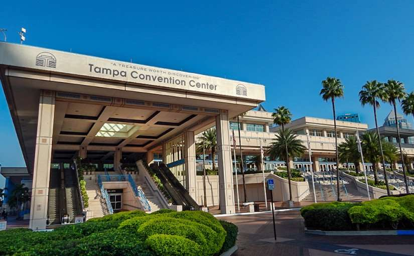 AUG 9, 2015 - Tampa Convention Center side entrance with escalators leading to 2nd floor with a door on 1st floor marked Channelside/photonews247.com