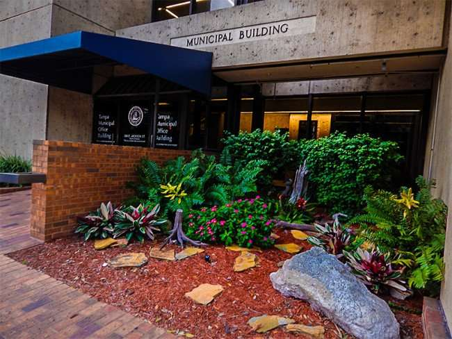 NOV 15. 2015 - Tampa Municipal Office Building front entrance with flower bed/photonews247.com