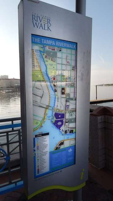 AUG 9, 2015 - The Tampa Riverwalk map behind Tampa Convention Center with The Westin Harbour Island in background/photonews247.com