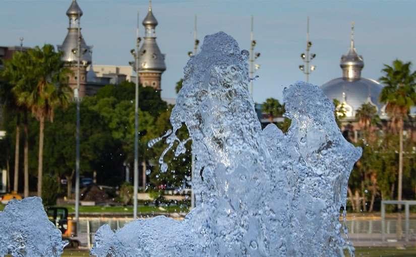 AUG 23, 2015 - Water fountain from Curtis Hixon Water Park with UT Moorish minarets, domes and cupolas/photonews247.com