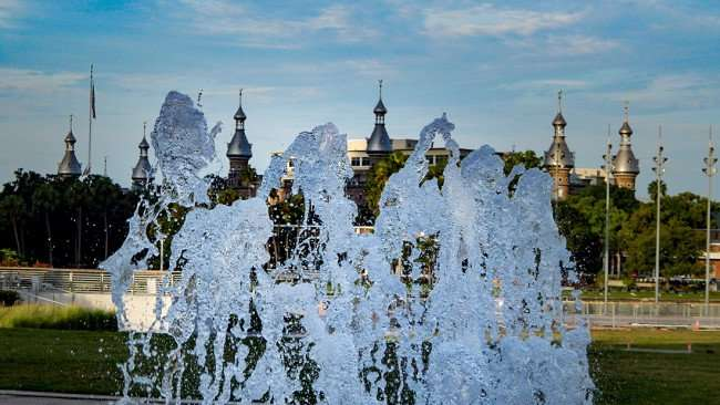 AUG 23, 2015 - Water fountains spring up at Curtis Hixon Water Park with UT Moorish minarets, domes and cupolas/photonews247.com
