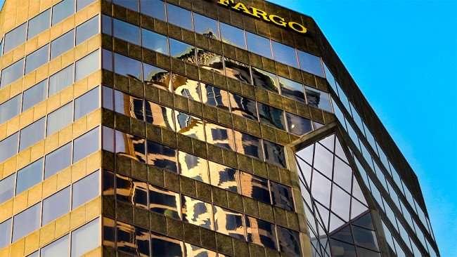 AUG 23, 2015 - Wells Fargo building on 100 South Ashley reflecting Regions building, Downtown Tampa, FL/photonews247.com