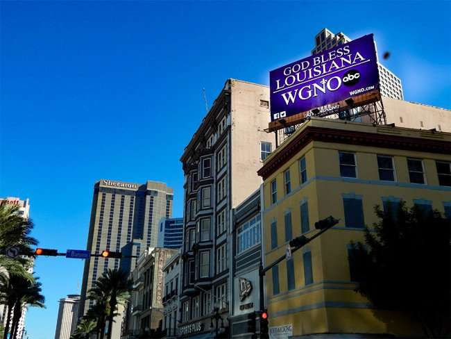 SEPT 13, 2015 - ABC WGNO says GOD BLESS LOUISIANA on billboard on Canel Street, New Orleans/photonews247.com