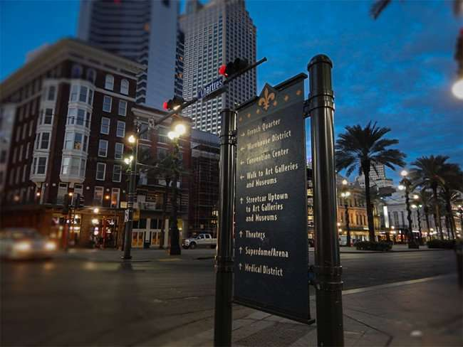 NOV 19, 2015 - Banner sign on Canal St and Chartres St with arrows pointing to attractions help tourists get around New Orleans, LA/photonews247.com