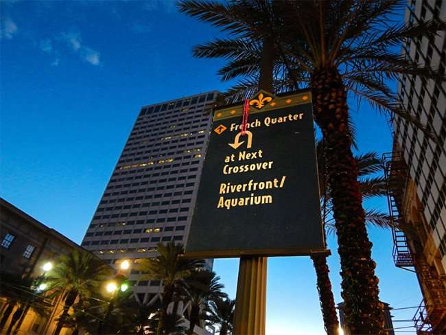 NOV 19, 2015 - Banner with arrow pointing to French Quarter and Riverfront and Aquarium on Canal St, New Orleans, LA/photonews247.com