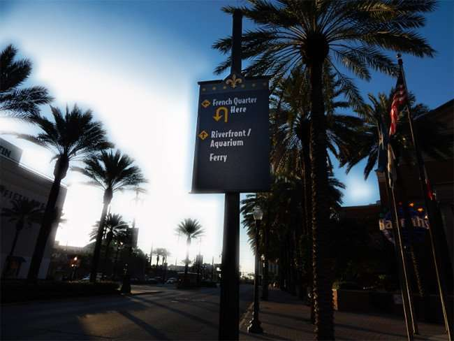 SEPT 14, 2015 - Banners of street poles with directional arrows pointing to French Quarter, Riverfront, Aquarium and Ferry in New Orleans, LA/photonews247.com