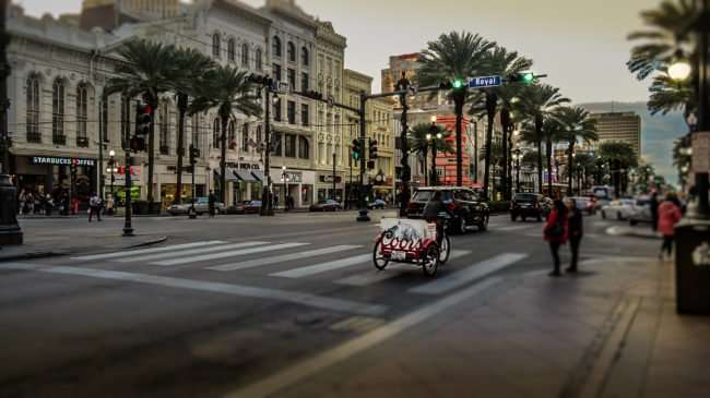 Jan 9, 2017 - Bike Taxi with Coors advertisement on back at Canal St and Royal, New Orleans, LA/photonews247.com