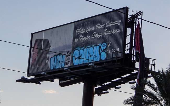 NOW 19, 2015 - Billboard on Canal Street with graffiti in New Orleans, LA/photonews247.com