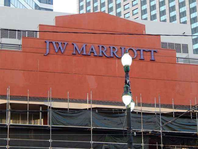 SEPT 13, 2015 - Black plastic and scaffolding covering front facade of JW Marriott New Orleans/photonews247.com