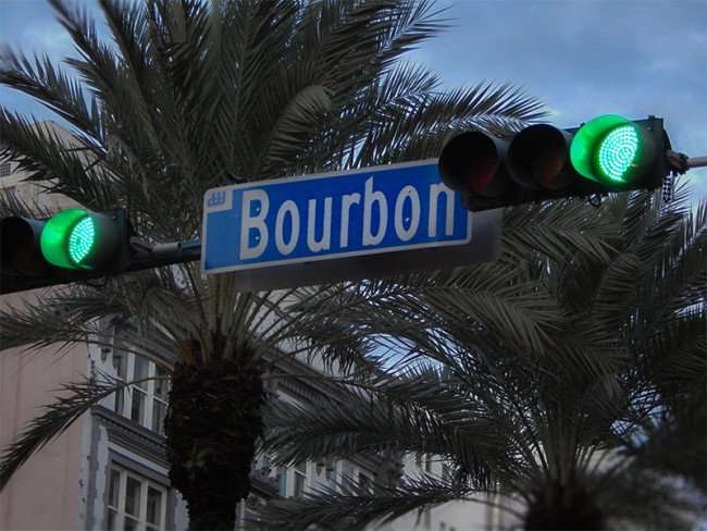 NOV 19, 2015 - Bourbon Street sign with horizontal traffic signal lights intersecting Canal Street, New Orleans, LA/photonews247.com